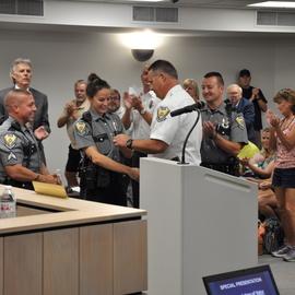 Photo of Cpl. Brad Doerger (L) Officer Abby Ballman (C) Officer Michael Gerde (R)