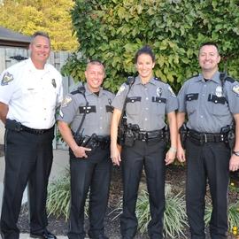 Photo of Left to Right - Col. Jim Howarth, Cpl. Brad Doerger, Officer Abby Ballman, Officer Michael Gerde